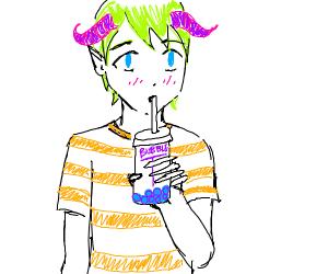 Horned boy drinks bubble tea