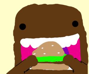 Domo eating a hamburger