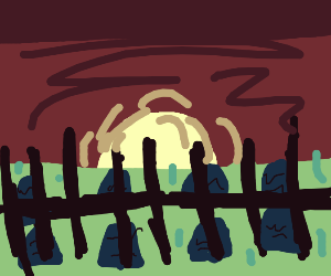 The gates to a grave yard at sunset