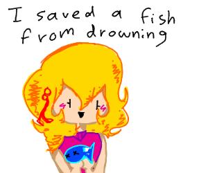 Cute girl holding a dead fish