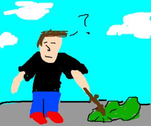 guy pokes a green blob