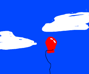 Red balloon in sky