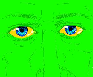 extreme closeup of lime green man w/blue eyes