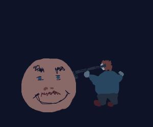 A man with only a head holdingupguntofatman
