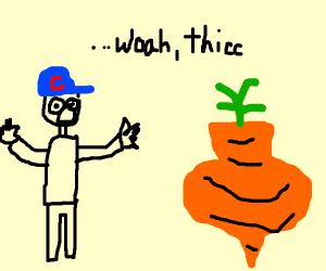 Boy Admiring Fat Carrot