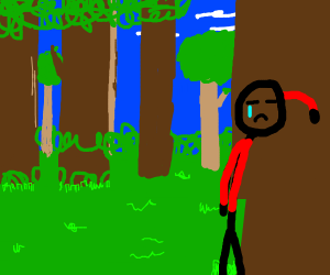 Sad person in red hoodie standing in forest