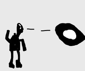 man looks at giant eye