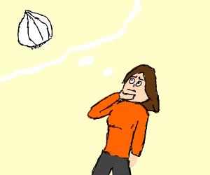 Girl contemplates stinking garlic