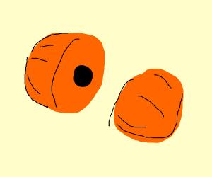Orange fruit w/ big black pit cut in half