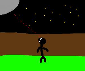 man stares at moon