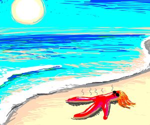 Sun roasting a red-headed creature on a beach