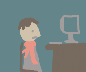 Sad man sitting on a desk