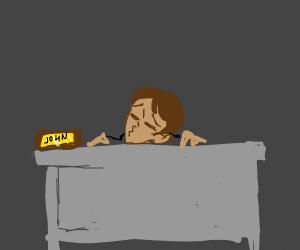 guy sleeping at his desk