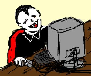 Happy Vampire using a Computer