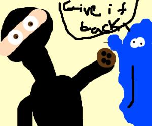 Ninja swipes cookie from Cookie Monster