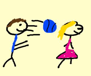 man throws blue football in woman's hair