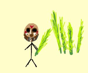 Farmer in field of fresh herbs