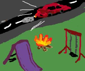 Car speeds past playground