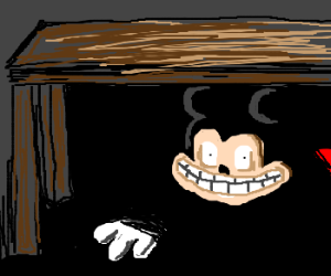 Mickey Mouse peaking under the table.