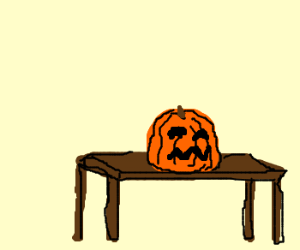 Trick or treat pumpkin on a desk