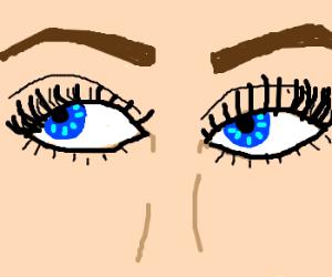 Feminine blue eyes look to the upperleft