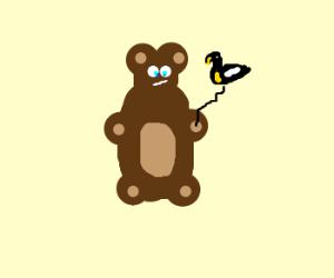 A bear with a duck balloon.