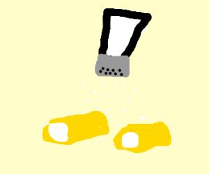 Salt being put on mini-twinkies