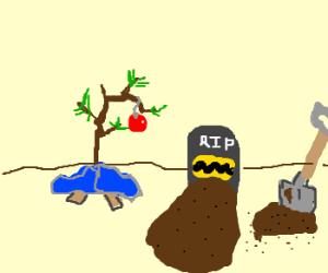 Charlie brown buried next to Christmas tree