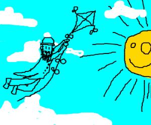 A man with a kite heading toward the sun