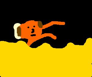 A bald man swimming in an ocean of custard