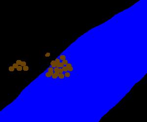Man damming a river