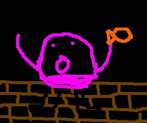 Humpty-Dumpty eating a fish