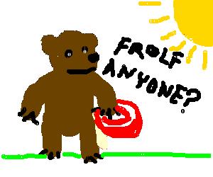 bear has Frisbee, is in sun