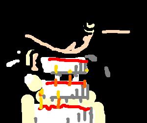 Naked man sits on birthday cake