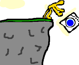 A gold man throwing washing machine off a cliff