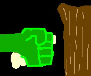The hulk knocks over a tree