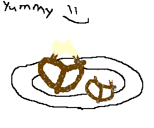 Half-eaten pretzel on a plate