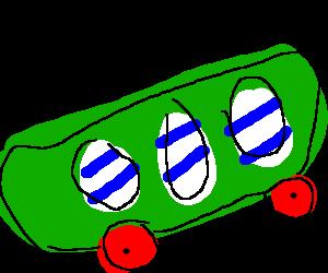 Green skateboard patterned w 3 blue striped eggs