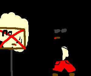 Cool kid smokes next to no-smoking sign