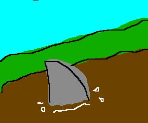 Shark fin swims through dirt