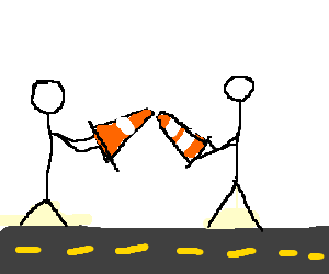 Two men holding traffic cones