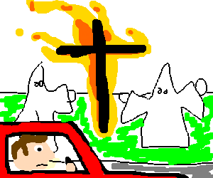 man drves past the kkk