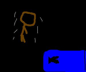 Hovering man sleeping next to piranha tank.