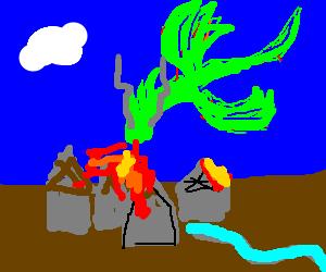 A dragon burns a town down