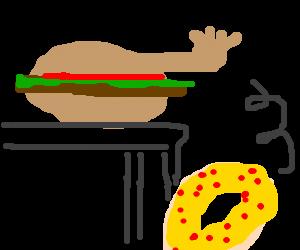 hamburger helper hand drops donut off the table