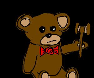 Bowtie wearing bear wields a judge's Gavel