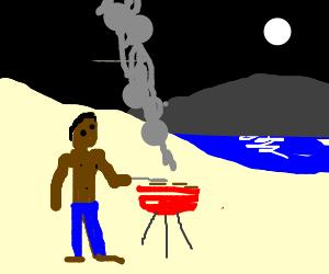Brown man having BBQ by moonlit lake