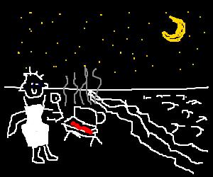 black man makes a barbecue at night at the beach