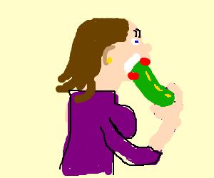 Woman eats cucumber