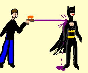 A man with an ink gun attacks batgirl